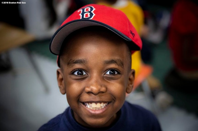 BOSTON, MA - APRIL 4: A student reacts as he receives a Boston Red Sox hat during a hat donation event at the Hurley School on April 4, 2018 in Boston, Massachusetts. (Photo by Billie Weiss/Boston Red Sox/Getty Images) *** Local Caption ***