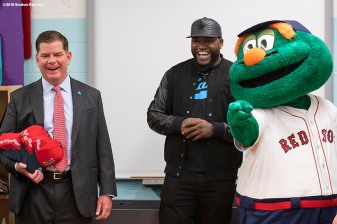 BOSTON, MA - APRIL 4: Boston Mayor Marty Walsh, Former Boston Red Sox designated hitter David Ortiz, and mascot Wally the Green Monster speak to students during a hat donation event at the Hurley School on April 4, 2018 in Boston, Massachusetts. (Photo by Billie Weiss/Boston Red Sox/Getty Images) *** Local Caption *** David Ortiz; Marty Walsh;