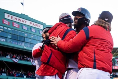 BOSTON, MA - APRIL 5: Hanley Ramirez #13 of the Boston Red Sox reacts with teammates after hitting a game winning walk-off single during the twelfth inning of the Opening Day game against the Tampa Bay Rays on April 5, 2018 at Fenway Park in Boston, Massachusetts. (Photo by Billie Weiss/Boston Red Sox/Getty Images) *** Local Caption *** Hanley Ramirez