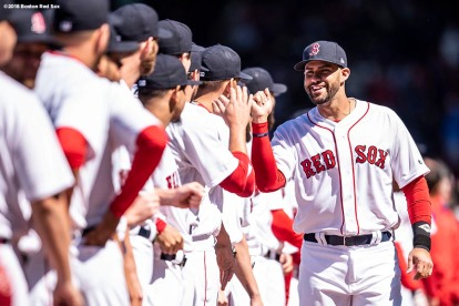 BOSTON, MA - APRIL 5: J.D. Martinez #28 of the Boston Red Sox high fives teammates as he is introduced before the Opening Day game against the Tampa Bay Rays on April 5, 2018 at Fenway Park in Boston, Massachusetts. (Photo by Billie Weiss/Boston Red Sox/Getty Images) *** Local Caption *** J.D. Martinez
