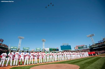 BOSTON, MA - APRIL 5: A flyover is held as members of the Boston Red Sox stand during the national anthem before the Opening Day game against the Tampa Bay Rays on April 5, 2018 at Fenway Park in Boston, Massachusetts. (Photo by Billie Weiss/Boston Red Sox/Getty Images) *** Local Caption ***