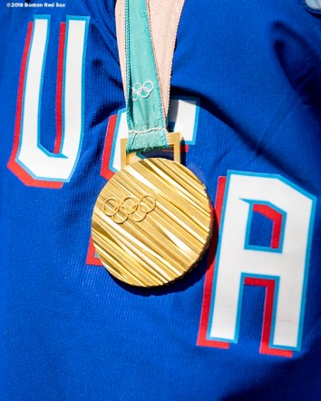 BOSTON, MA - APRIL 5: The gold medal won by the United States Women's Olympic Hockey team is displayed before the the Opening Day game between the Boston Red Sox and the Tampa Bay Rays on April 5, 2018 at Fenway Park in Boston, Massachusetts. (Photo by Billie Weiss/Boston Red Sox/Getty Images) *** Local Caption ***
