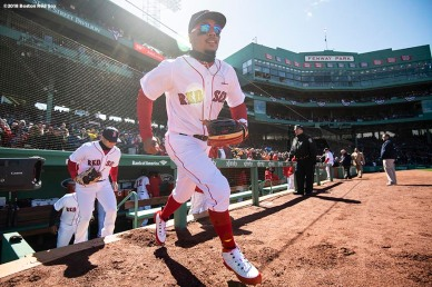 BOSTON, MA - APRIL 5: Mookie Betts #50 of the Boston Red Sox runs onto the field before the Opening Day game against the Tampa Bay Rays on April 5, 2018 at Fenway Park in Boston, Massachusetts. (Photo by Billie Weiss/Boston Red Sox/Getty Images) *** Local Caption *** Mookie Betts
