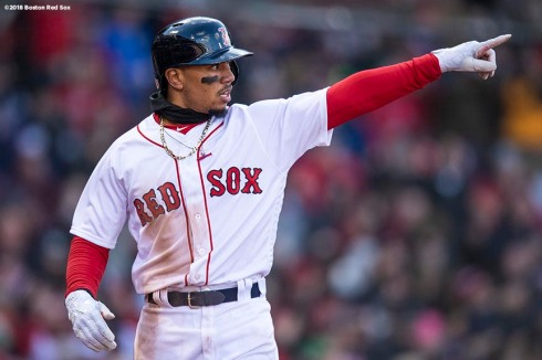 BOSTON, MA - APRIL 5: Mookie Betts #50 of the Boston Red Sox reacts after scoring during the ninth inning of the Opening Day game against the Tampa Bay Rays on April 5, 2018 at Fenway Park in Boston, Massachusetts. (Photo by Billie Weiss/Boston Red Sox/Getty Images) *** Local Caption *** Mookie Betts