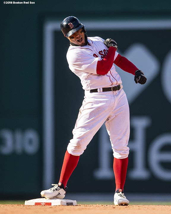 BOSTON, MA - APRIL 5: Xander Bogaerts #2 of the Boston Red Sox reacts after hitting a game tying RBI double during the ninth inning of the Opening Day game against the Tampa Bay Rays on April 5, 2018 at Fenway Park in Boston, Massachusetts. (Photo by Billie Weiss/Boston Red Sox/Getty Images) *** Local Caption *** Xander Bogaerts