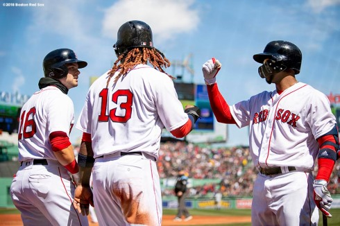 BOSTON, MA - APRIL 7: Andrew Benintendi #16 and Hanley Ramirez #13 of the Boston Red Sox high five Eduardo Nunez #36 after scoring during the first inning of a game against the Tampa Bay Rays on April 7, 2018 at Fenway Park in Boston, Massachusetts. (Photo by Billie Weiss/Boston Red Sox/Getty Images) *** Local Caption *** Andrew Benintendi; Hanley Ramirez; Eduardo Nunez