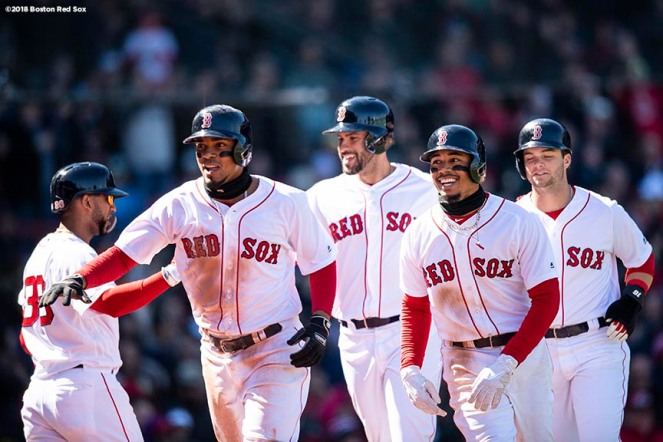 BOSTON, MA - APRIL 7: Xander Bogaerts #2 of the Boston Red Sox reacts with J.D. Martinez #28, Mookie Betts #50, Eduardo Nunez #36 and Andrew Benintendi #16 after hitting a grand slam home run during the second inning of a game against the Tampa Bay Rays on April 7, 2018 at Fenway Park in Boston, Massachusetts. (Photo by Billie Weiss/Boston Red Sox/Getty Images) *** Local Caption *** Xander Bogaerts; J.D. Martinez; Andrew Benintendi; Mookie Betts; Eduardo Nunez
