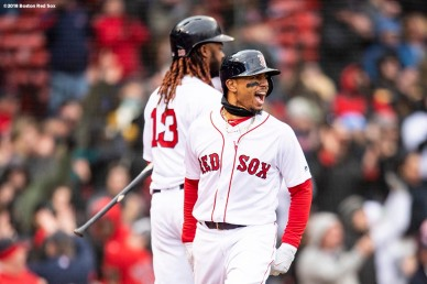 BOSTON, MA - APRIL 8: Mookie Betts #50 of the Boston Red Sox reacts with Hanley Ramirez #13 after scoring the go ahead run during the eighth inning of a game against the Tampa Bay Rays on April 8, 2018 at Fenway Park in Boston, Massachusetts. (Photo by Billie Weiss/Boston Red Sox/Getty Images) *** Local Caption *** Mookie Betts; Hanley Ramirez