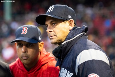 BOSTON, MA - APRIL 10: Manager Alex Cora of the Boston Red Sox looks on with manager Aaron Boone of the New York Yankees before a game on April 10, 2018 at Fenway Park in Boston, Massachusetts. (Photo by Billie Weiss/Boston Red Sox/Getty Images) *** Local Caption *** Alex Cora; Aaron Boone