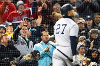 BOSTON, MA - APRIL 10: A fan reacts as Giancarlo Stanton #27 of the New York Yankees walks to the dugout after striking out during the third inning of a game against the Boston Red Sox on April 10, 2018 at Fenway Park in Boston, Massachusetts. (Photo by Billie Weiss/Boston Red Sox/Getty Images) *** Local Caption *** Giancarlo Stanton
