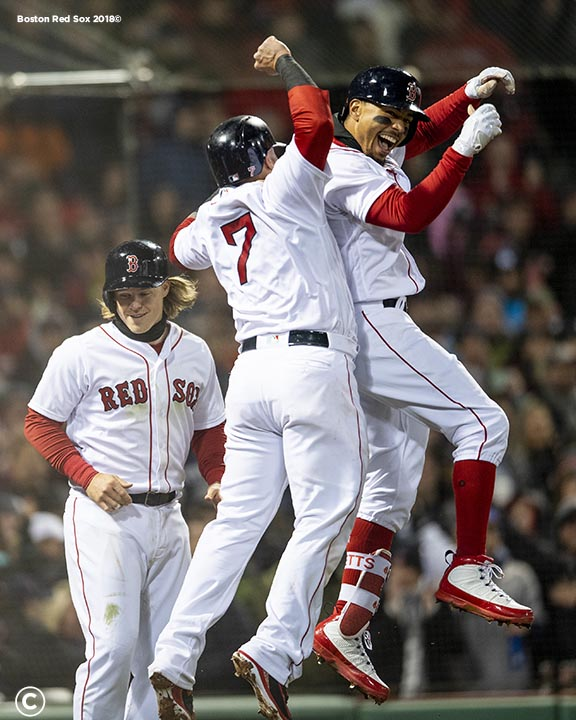 BOSTON, MA - APRIL 10: Mookie Betts #50 of the Boston Red Sox reacts with Christian Vazquez #7 and Brock Holt #12 after hitting a grand slam home run during the sixth inning of a game against the New York Yankees on April 10, 2018 at Fenway Park in Boston, Massachusetts. (Photo by Billie Weiss/Boston Red Sox/Getty Images) *** Local Caption *** Mookie Betts; Christian Vazquez; Brock Holt