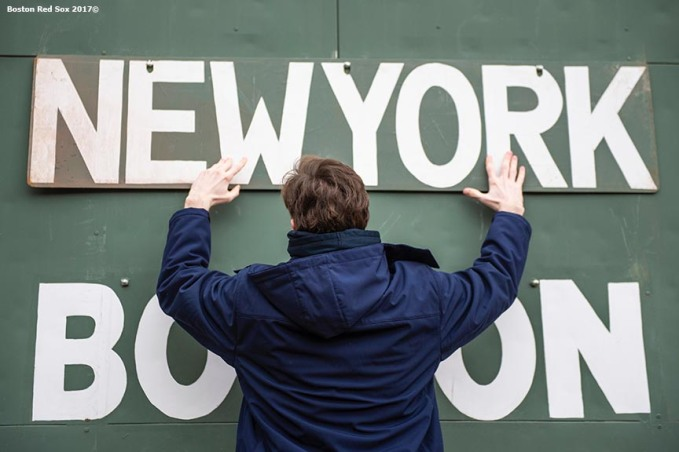BOSTON, MA - APRIL 10: Signs are hung on the Green monster scoreboard before a game between the Boston Red Sox and the New York Yankees on April 10, 2018 at Fenway Park in Boston, Massachusetts. (Photo by Billie Weiss/Boston Red Sox/Getty Images) *** Local Caption ***