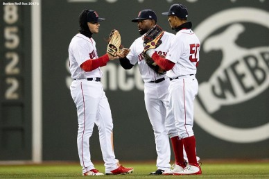BOSTON, MA - APRIL 10: Andrew Benintendi #16, Jackie Bradley Jr. #19, and Mookie Betts #50 of the Boston Red Sox celebrate a victory against the New York Yankees on April 10, 2018 at Fenway Park in Boston, Massachusetts. (Photo by Billie Weiss/Boston Red Sox/Getty Images) *** Local Caption *** Andrew Benintendi; Mookie Betts; Jackie Bradley Jr.
