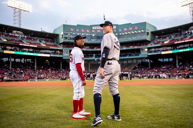 BOSTON, MA - APRIL 11: Mookie Betts #50 of the Boston Red Sox talks with Aaron Judge #99 of the New York Yankees before a game on April 11, 2018 at Fenway Park in Boston, Massachusetts. (Photo by Billie Weiss/Boston Red Sox/Getty Images) *** Local Caption *** Mookie Betts; Aaron Judge