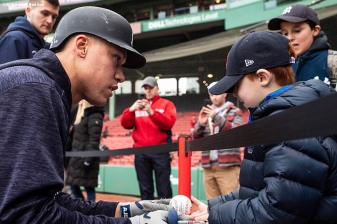 BOSTON, MA - APRIL 11: Aaron Judge #99 of the New York Yankees signs an autograph for a young fan of the Boston Red Sox before a game on April 11, 2018 at Fenway Park in Boston, Massachusetts. (Photo by Billie Weiss/Boston Red Sox/Getty Images) *** Local Caption *** Aaron Judge
