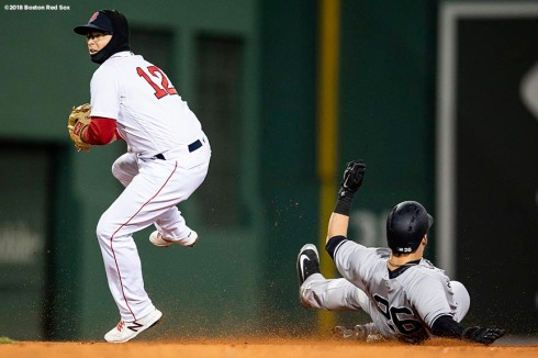 BOSTON, MA - APRIL 11: Tyler Austin #26 of the New York Yankees slides into second base after Brock Holt #12 of the Boston Red Sox records the out during the third inning of a game on April 11, 2018 at Fenway Park in Boston, Massachusetts. The play led to a benches clearing argument. (Photo by Billie Weiss/Boston Red Sox/Getty Images) *** Local Caption *** Tyler Austin; Brock Holt