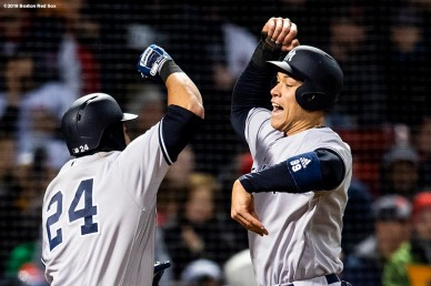 BOSTON, MA - APRIL 11: Gary Sanchez #24 of the New York Yankees reacts with Aaron Judge #99 after hitting a two run home run during the fourth inning of a game against the Boston Red Sox on April 11, 2018 at Fenway Park in Boston, Massachusetts. (Photo by Billie Weiss/Boston Red Sox/Getty Images) *** Local Caption *** Gary Sanchez; Aaron Judge