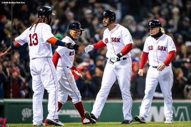 BOSTON, MA - APRIL 11: J.D. Martinez #28 of the Boston Red Sox reacts with Brock Holt #12, Mookie Betts #50, and Hanley Ramirez #13 after hitting a grand slam home run during the fifth inning of a game against the New York Yankees on April 11, 2018 at Fenway Park in Boston, Massachusetts. (Photo by Billie Weiss/Boston Red Sox/Getty Images) *** Local Caption *** J.D. Martinez; Brock Holt; Hanley Ramirez; Mookie Betts