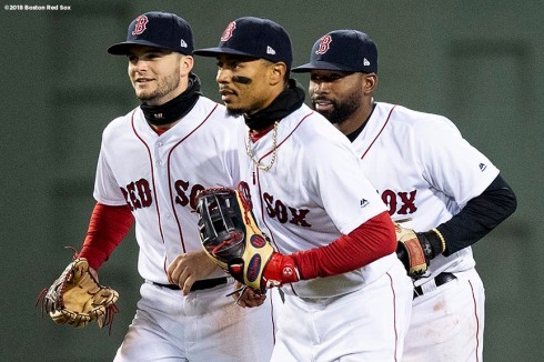 BOSTON, MA - APRIL 12: Andrew Benintendi #18, Mookie Betts #50, and Jackie Bradley Jr. #19 of the Boston Red Sox celebrate a victory against the New York Yankees on April 12, 2018 at Fenway Park in Boston, Massachusetts. (Photo by Billie Weiss/Boston Red Sox/Getty Images) *** Local Caption *** Andrew Benintendi; Mookie Betts; Jackie Bradley Jr.