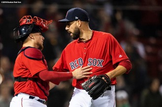 BOSTON, MA - APRIL 13: Matt Barnes #63 of the Boston Red Sox celebrates a victory with Christian Vazquez #7 against the Baltimore Orioles on April 13, 2018 at Fenway Park in Boston, Massachusetts. (Photo by Billie Weiss/Boston Red Sox/Getty Images) *** Local Caption *** Matt Barnes; Christian Vazquez