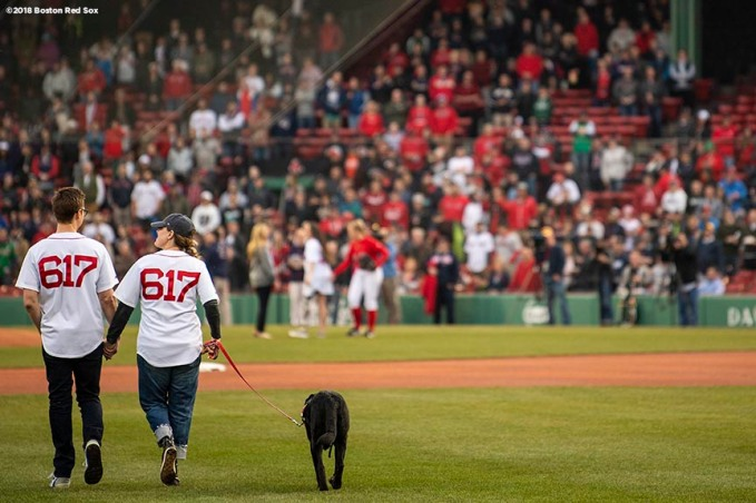 BOSTON, MA - APRIL 13: Boston Marathon bombing survivors Patrick Downes and Jessica Kensky are introduced during a ceremony before a game between the Boston Red Sox and the Baltimore Orioles on April 13, 2018 at Fenway Park in Boston, Massachusetts. (Photo by Billie Weiss/Boston Red Sox/Getty Images) *** Local Caption *** Patrick Downes; Jessica Kensky