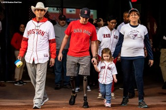 BOSTON, MA - APRIL 13: Boston Marathon bombing rescuer Carlos Arredondo and his wife Melida, and survivors Jeff Bauman and Nicole Simmonds are introduced during a ceremony before a game between the Boston Red Sox and the Baltimore Orioles on April 13, 2018 at Fenway Park in Boston, Massachusetts. (Photo by Billie Weiss/Boston Red Sox/Getty Images) *** Local Caption *** Jeff Bauman; Nicole Simmonds; Carlos Arredondo