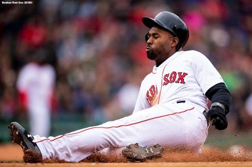 BOSTON, MA - APRIL 14: Jackie Bradley Jr. #19 of the Boston Red Sox slides into first base during the fifth inning of a game against the Baltimore Orioles on April 14, 2018 at Fenway Park in Boston, Massachusetts. (Photo by Billie Weiss/Boston Red Sox/Getty Images) *** Local Caption *** Jackie Bradley Jr.
