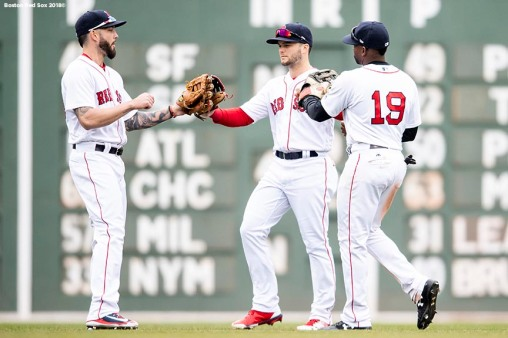 BOSTON, MA - APRIL 14: Blake Swihart #23, Andrew Benintendi #16, and Jackie Bradley Jr. #19 of the Boston Red Sox celebrate a victory against the Baltimore Orioles on April 14, 2018 at Fenway Park in Boston, Massachusetts. (Photo by Billie Weiss/Boston Red Sox/Getty Images) *** Local Caption *** Blake Swihart; Andrew Benintendi; Jackie Bradley Jr.