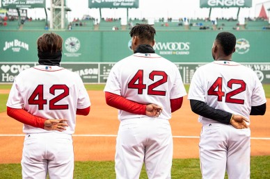 BOSTON, MA - APRIL 15: Tzu-Wei Lin #5, Rafael Devers #11, and Jackie Bradley Jr. #19 of the Boston Red Sox wear the number 42 in recognition of Jackie Robinson Day before a game against the Baltimore Orioles on April 15, 2018 at Fenway Park in Boston, Massachusetts. (Photo by Billie Weiss/Boston Red Sox/Getty Images) *** Local Caption *** Tzu-Wei Lin, Rafael Devers, Jackie Bradley Jr.