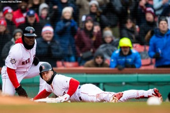 BOSTON, MA - APRIL 15: Andrew Benintendi #16 of the Boston Red Sox slides into third base after hitting a game tying RBI triple during the fifth inning of a game against the Baltimore Orioles on April 15, 2018 at Fenway Park in Boston, Massachusetts. (Photo by Billie Weiss/Boston Red Sox/Getty Images) *** Local Caption *** Andrew Benintendi