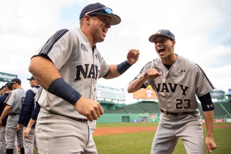 BOSTON, MA - APRIL 20: Members of the Naval Academy high five before a game against Army West Point on April 20, 2018 at Fenway Park in Boston, Massachusetts. (Photo by Billie Weiss/Boston Red Sox/Getty Images) *** Local Caption ***