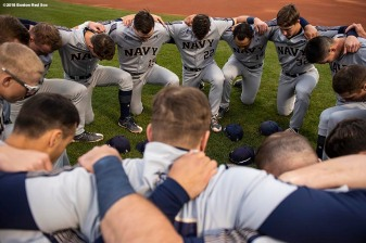BOSTON, MA - APRIL 20: Members of the Naval Academy say a team prayer before a game against Army West Point on April 20, 2018 at Fenway Park in Boston, Massachusetts. (Photo by Billie Weiss/Boston Red Sox/Getty Images) *** Local Caption ***