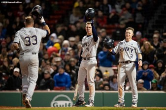 BOSTON, MA - APRIL 20: Christian Hodge #33 of the Naval Academy reacts with teammates after hitting a home run during the sixth inning of a game against Army West Point on April 20, 2018 at Fenway Park in Boston, Massachusetts. (Photo by Billie Weiss/Boston Red Sox/Getty Images) *** Local Caption *** Christian Hodge