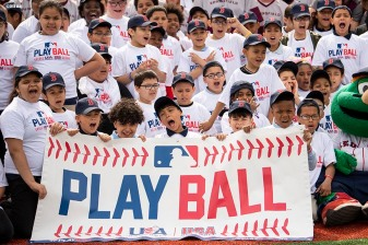 SPRINGFIELD, MA. - APRIL 27: Participants react as they pose for a group photo during a Major League Baseball Play Ball event on Friday, April 27, 2018 at Berry-Allen Field at Springfield College in Springfield, Massachusetts. (Photo by Billie Weiss/MLB Photos via Getty Images) *** Local Caption ***