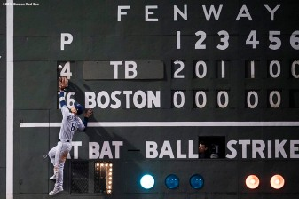 BOSTON, MA - APRIL 27: Rob Refsnyder #8 of the Tampa Bay Rays leaps as he attempts to catch a fly ball off of the Green Monster scoreboard during the sixth inning of a game against the Boston Red Sox on April 27, 2018 at Fenway Park in Boston, Massachusetts. (Photo by Billie Weiss/Boston Red Sox/Getty Images) *** Local Caption *** Rob Refsnyder