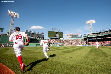 BOSTON, MA - APRIL 28: Andrew Benintendi #16, Jackie Bradley Jr. #19, and Mookie Betts #50 of the Boston Red Sox run onto the field before a game against the Tampa Bay Rays on April 28, 2018 at Fenway Park in Boston, Massachusetts. (Photo by Billie Weiss/Boston Red Sox/Getty Images) *** Local Caption *** Andrew Benintendi