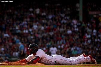 BOSTON, MA - APRIL 28: Eduardo Nunez #36 of the Boston Red Sox slides into first base during the third inning of a game against the Tampa Bay Rays on April 28, 2018 at Fenway Park in Boston, Massachusetts. (Photo by Billie Weiss/Boston Red Sox/Getty Images) *** Local Caption *** Eduardo Nunez