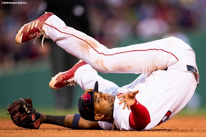 BOSTON, MA - APRIL 28: Eduardo Nunez #36 of the Boston Red Sox reacts as he trips after fielding a throw from the outfield during the eighth inning of a game against the Tampa Bay Rays on April 28, 2018 at Fenway Park in Boston, Massachusetts. (Photo by Billie Weiss/Boston Red Sox/Getty Images) *** Local Caption *** Eduardo Nunez