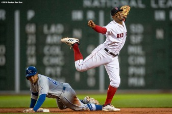 BOSTON, MA - APRIL 30: Xander Bogaerts #2 of the Boston Red Sox turns a double play over Jon Jay #25 of the Kansas City Royals during the first inning of a game on April 30, 2018 at Fenway Park in Boston, Massachusetts. (Photo by Billie Weiss/Boston Red Sox/Getty Images) *** Local Caption *** Xander Bogaerts; Jon Jay
