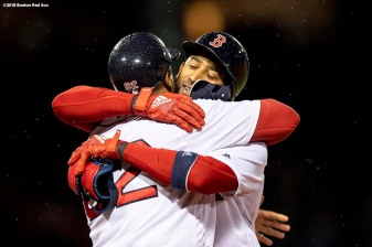 BOSTON, MA - APRIL 30: Eduardo Nunez #36 of the Boston Red Sox hugs first base coach Tom Goodwin after hitting an RBI single during the fifth inning of a game against the Kansas City Royals on April 30, 2018 at Fenway Park in Boston, Massachusetts. (Photo by Billie Weiss/Boston Red Sox/Getty Images) *** Local Caption *** Eduardo Nunez; Tom Goodwin