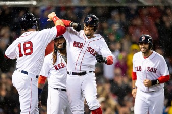BOSTON, MA - APRIL 30: Xander Bogaerts #2 of the Boston Red Sox reacts with Mitch Moreland #18, Hanley Ramirez #13 and J.D. Martinez #28 after hitting a grand slam home run during the third inning of a game against the Kansas City Royals on April 30, 2018 at Fenway Park in Boston, Massachusetts. (Photo by Billie Weiss/Boston Red Sox/Getty Images) *** Local Caption *** Xander Bogaerts; J.D. Martinez; Hanley Ramirez; Hanley Ramirez
