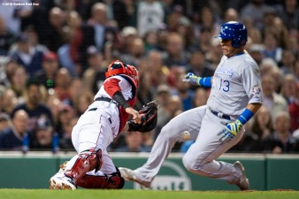 BOSTON, MA - MAY 1: Salvador Perez #13 of the Kansas City Royals evades the tag of Christian Vazquez #7 of the Boston Red Sox to score during the fourth inning of a game on May 1, 2018 at Fenway Park in Boston, Massachusetts. (Photo by Billie Weiss/Boston Red Sox/Getty Images) *** Local Caption *** Salvador Perez; Christian Vazquez