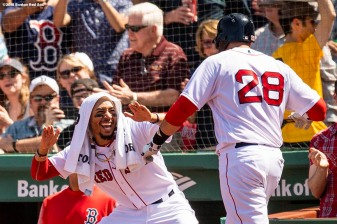 BOSTON, MA - MAY 2: J.D Martinez #28 of the Boston Red Sox reacts with Mookie Betts after hitting a two run home run during the fourth inning of a game against the Kansas City Royals on May 2, 2018 at Fenway Park in Boston, Massachusetts. (Photo by Billie Weiss/Boston Red Sox/Getty Images) *** Local Caption *** J.D. Martinez; Mookie Betts
