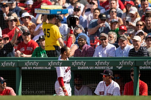BOSTON, MA - MAY 2: Mookie Betts #50 of the Boston Red Sox gives a curtain call after hitting a solo home run during the seventh inning of a game against the Kansas City Royals on May 2, 2018 at Fenway Park in Boston, Massachusetts. It was his third home run of the game. (Photo by Billie Weiss/Boston Red Sox/Getty Images) *** Local Caption *** Mookie Betts