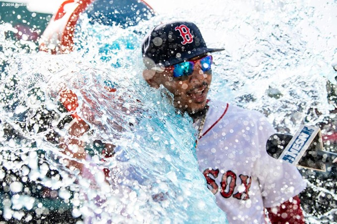 BOSTON, MA - MAY 2: Mookie Betts #50 of the Boston Red Sox is doused with Gatorade after hitting three home runs in a victory against the Kansas City Royals on May 2, 2018 at Fenway Park in Boston, Massachusetts. (Photo by Billie Weiss/Boston Red Sox/Getty Images) *** Local Caption *** Mookie Betts