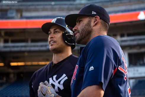 NEW YORK, NY - MAY 8: J.D. Martinez #28 of the Boston Red Sox reacts with Giancarlo Stanton #217 of the New York Yankees before a game on May 8, 2018 at Yankee Stadium in the Bronx borough of New York City. (Photo by Billie Weiss/Boston Red Sox/Getty Images) *** Local Caption *** J.D. Martinez; Giancarlo Stanton