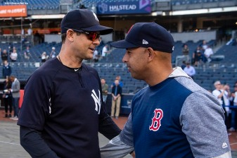 NEW YORK, NY - MAY 8: Manager Alex Cora of the Boston Red Sox withs with Manager Aaron Boone of the New York Yankees before a game on May 8, 2018 at Yankee Stadium in the Bronx borough of New York City. (Photo by Billie Weiss/Boston Red Sox/Getty Images) *** Local Caption *** Alex Cora; Aaron Boone