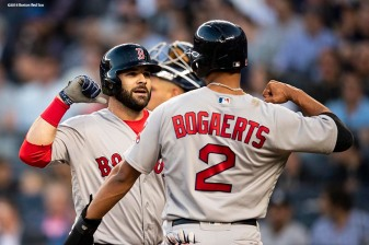 NEW YORK, NY - MAY 9: Mitch Moreland #18 of the Boston Red Sox reacts with Xander Bogaerts #2 after hitting a two run home run during the second inning of a game against the New York Yankees on May 9, 2018 at Yankee Stadium in the Bronx borough of New York City. (Photo by Billie Weiss/Boston Red Sox/Getty Images) *** Local Caption *** Mitch Moreland; Xander Bogaerts