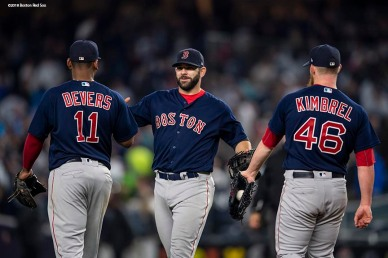 NEW YORK, NY - MAY 10: Mitch Moreland #18, Rafael Devers #11, and Craig Kimbrel #46 of the Boston Red Sox celebrate a victory against the New York Yankees on May 10, 2018 at Yankee Stadium in the Bronx borough of New York City. (Photo by Billie Weiss/Boston Red Sox/Getty Images) *** Local Caption *** Craig Kimbrel; Mitch Moreland; Rafael Devers