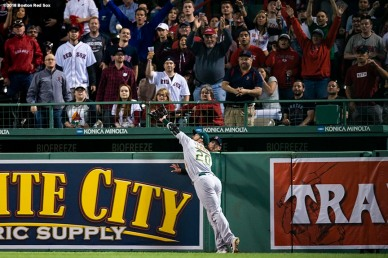 BOSTON, MA - MAY 14: Mark Canha #20 of the Oakland Athletics attempts to catch a home run ball hit by J.D. Martinez #28 of the Boston Red Sox during the eighth inning of a game on May 14, 2018 at Fenway Park in Boston, Massachusetts. (Photo by Billie Weiss/Boston Red Sox/Getty Images) *** Local Caption *** Mark Canha